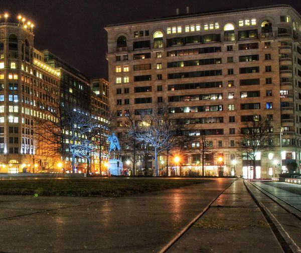 Illuminated city buildings