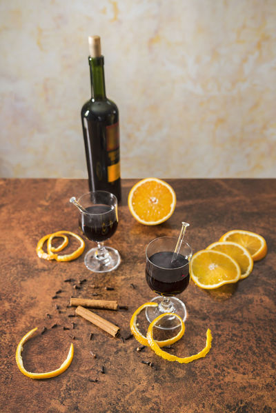 Mulled wine with spices and oranges Autumn Christmas Copy Space From Above  Glasses Ingredients Red Wine Rust Studio Vertically Winter Alcohol Cinnamon Cloves Drink Freshly Home Made Hot Drink Hot Wine Mulled Wine Oranges Spices Top View Warmth Wine