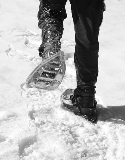 man runs with snowshoes in mountains with black and white effect Excursion Leg Snowshoe Winter Adventure Cold Equipment Extreme Sports Legs Mountains One Person People Shoes Snow Snow Shoe Snow Shoe Paws Snow Shoes Snowshoe Trip Snowshoeing Snowshoes Sport Sport Equipment Sporting Sportwear Walking