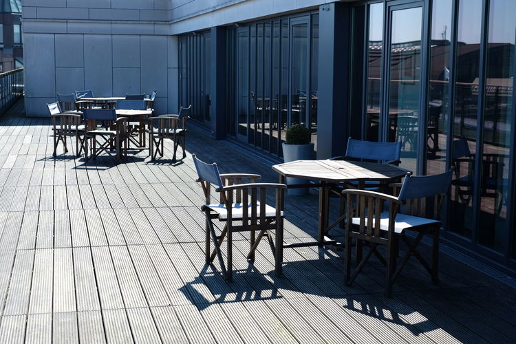 Empty chairs and tables outside restaurant