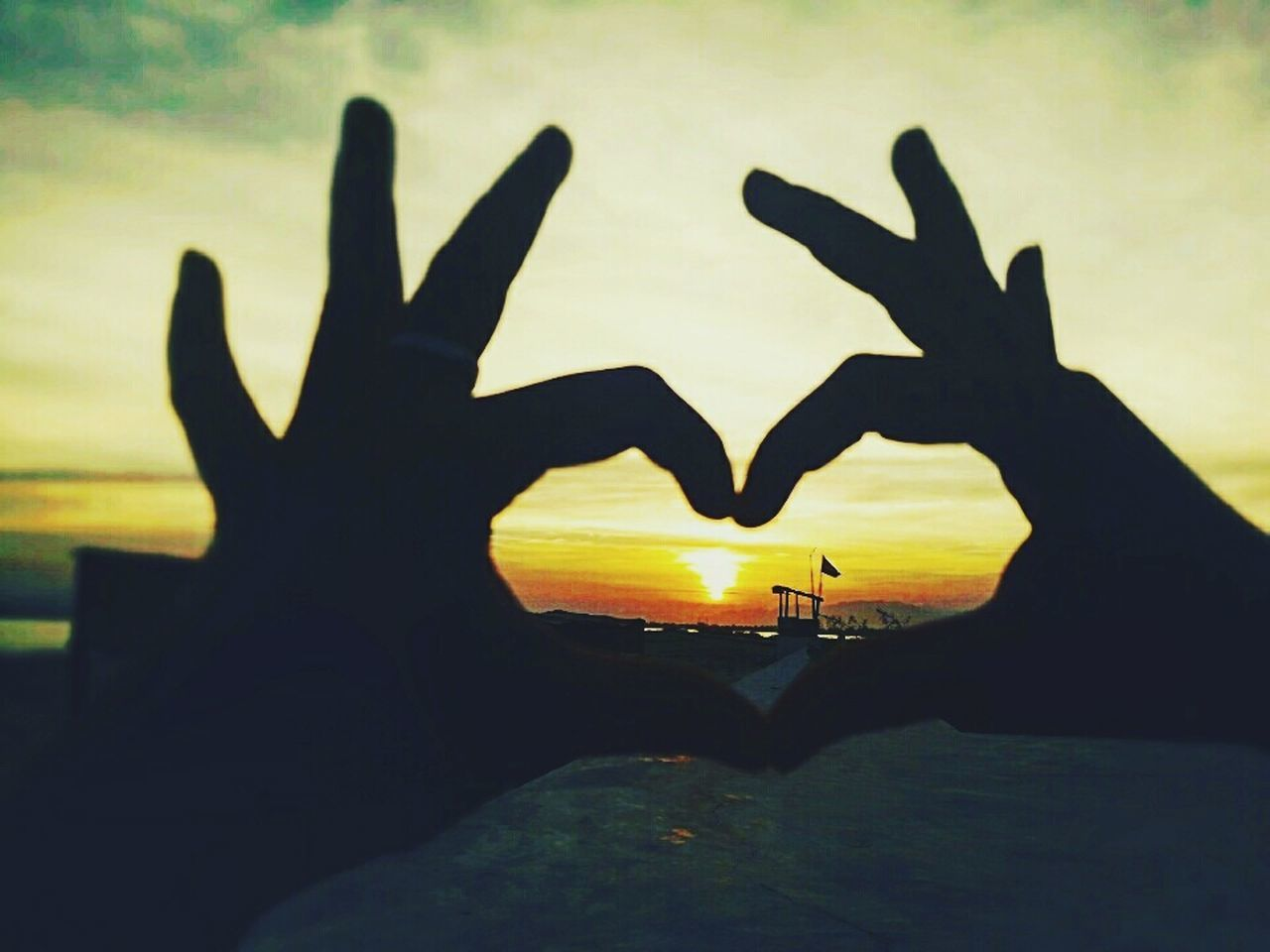 human hand, human finger, silhouette, sunset, heart shape, forming, shape, human body part, making, real people, one person, close-up, outdoors, nature, sky, day, people