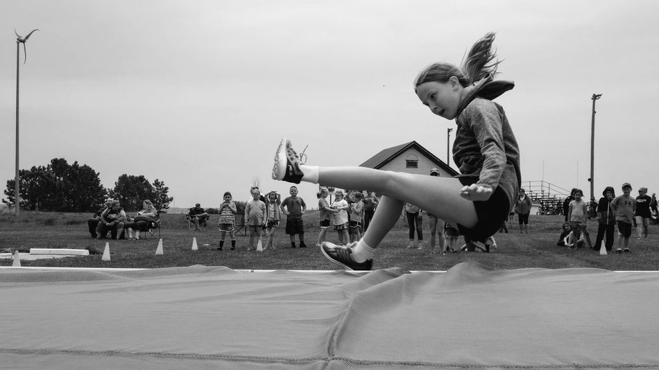 Meridian Public School Elementary Track & Field Day May 11, 2018 Daykin, Nebraska Americans Camera Work Daykin, Nebraska Elementary Track & Field Day Meridian Public School Kids Sports Rural America Small Town America Visual Journal Adult Casual Clothing City Day Documentary Elementary Age Fujifilm_xseries Full Length Group Of People Highjump Incidental People Leisure Activity Lifestyles Men Motion Nature Outdoors People Photo Diary Practicing Photography Real People S.ramos May 2018 School Side View Skill  Sky Small Town Stories Tree Women