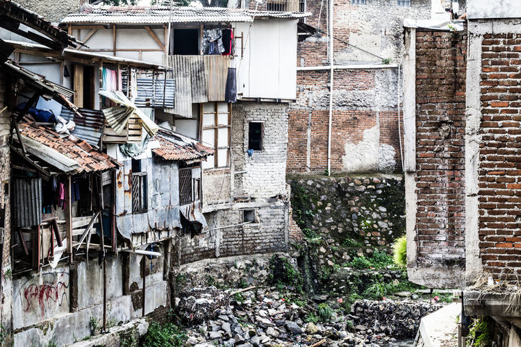 Clothes drying on wall of old building