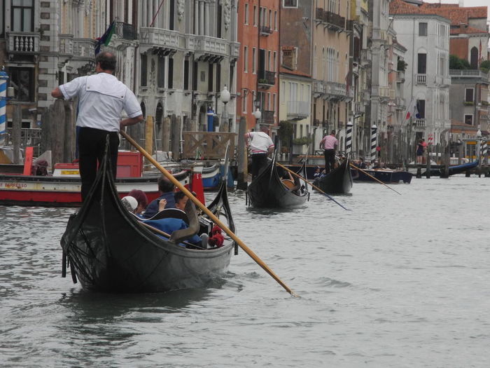 Rear view of gondolier in gondola on grand canal