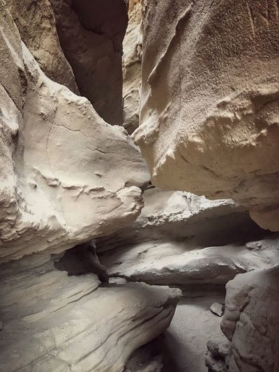 Narrow slot canyon in Anza Borrego desert state park Rock Formation Geology Rock - Object Physical Geography Nature Arid Climate No People Cave Backgrounds Beauty In Nature Landscape Rough Textured  Sandstone Day Travel Destinations Extreme Terrain Tranquility Desert Outdoors