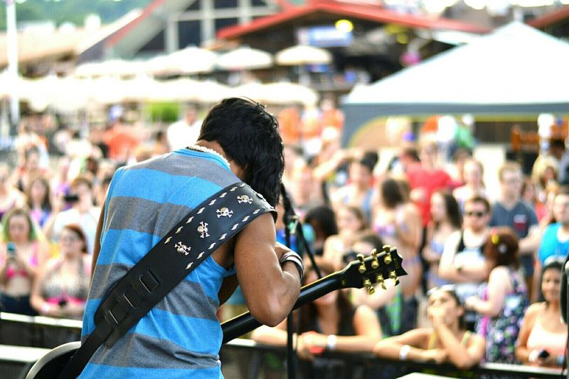Rear View Of Guitarist Performing During Music Concert