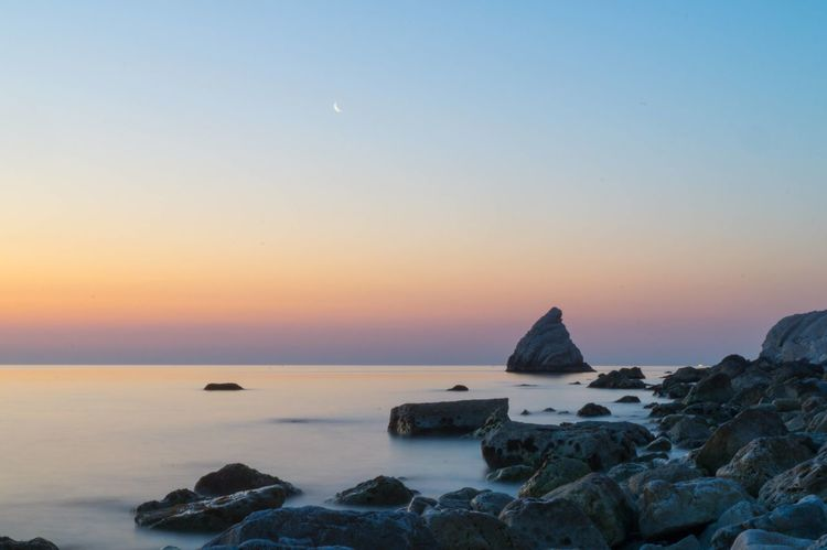 Seashore Beauty In Nature Clear Sky Colorful Sky Day Horizon Over Water Idyllic Nature No People Outdoors Rock Rock - Object Rocks Scenery Scenics Sea Sea And Sky Seascape Seaside Sky Sun Sunset Tranquil Scene Tranquility Water