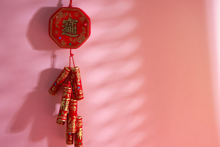 Close-up of red bell hanging in container