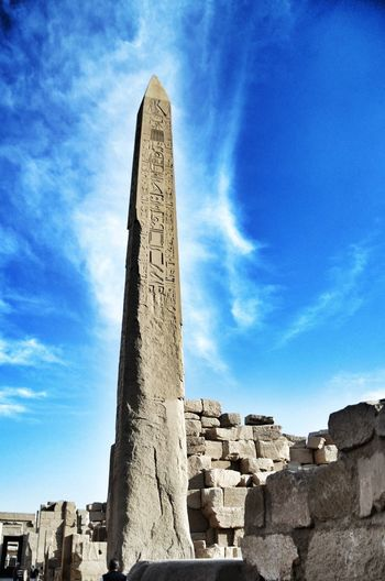 Low angle view of obelisk against blue sky