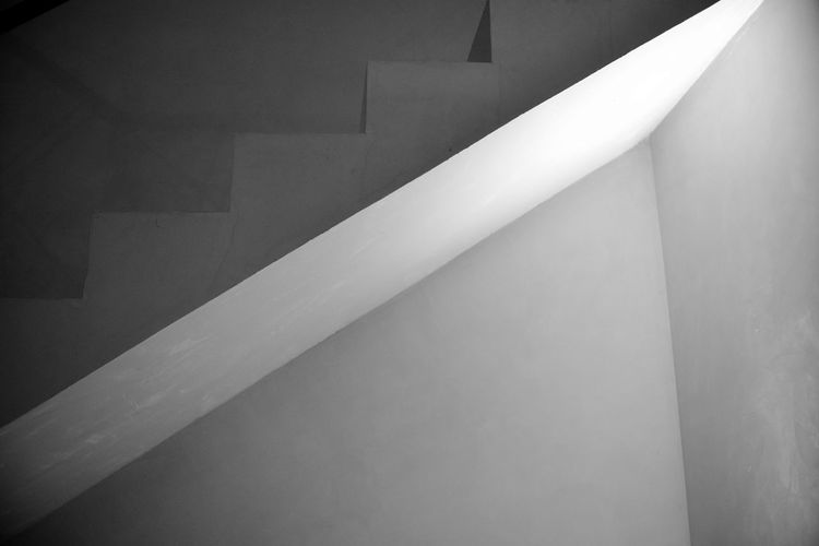 EyeEm Best Shots Eye4photography  Getting Inspired Architecture Built Structure Indoors  Steps And Staircases Staircase No People Wall - Building Feature Railing Ceiling Close-up Building Low Angle View Home Interior Illuminated Pattern Architectural Column Wall Blackandwhite Monochrome monochrome photography Fluorescent Light Design Geometric Shape The Minimalist - 2019 EyeEm Awards