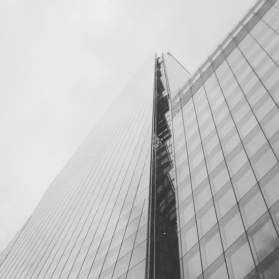 A picture of The Shard in London, taken from below. Architecture Built Structure Skyscraper Tower City Low Angle View Modern Tall - High Office Building Sky Tall Geometric Shape Capital Cities  Architectural Feature London Shard Shard London Shard Of Glass Shard glass First Eyeem Photo