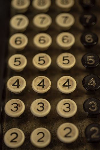 numbers on vintage cash register and adding machine keys Number Close-up Indoors  Communication No People Cash Register Vintage Number Keys Numbers Two Three Four Five Six Selective Focus Seven Adding Machine Old Fashioned