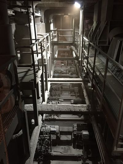 Indoors  Factory Industry Staircase Architecture No People Illuminated Metal Shelf Machinery Lighting Equipment Built Structure Equipment Steps And Staircases Manufacturing Technology In A Row Large Group Of Objects Manufacturing Equipment Industrial Equipment Production Line