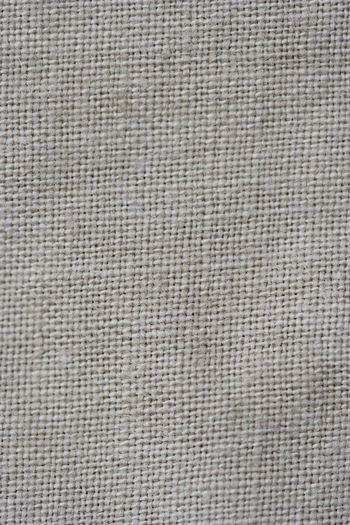 Close-up of a woven fabric - pure linen Background Backgrounds Canvas Close-up Cotton Detail Ecru Fabric Fashion Flax Full Frame Linen Macro Material Natural Pattern Purity Retro Textile Textile Industry Texture Textured  Textured  Textures And Surfaces Woven