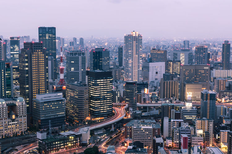 Osaka skyline in the Kansai province of Japan. Osaka is one of Japan largest city. Aerial View Architecture ASIA Building Exterior City City Life Cityscape Crowded Elevated Road High Angle View Illuminated Japan Kansai Modern Night OSAKA Outdoors Sky Skyscraper Sunset Travel Travel Destinations Urban Skyline Fresh On Market 2017