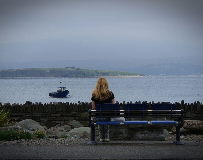 Watching The Tide Watching Life Go By Women Alone Tranquility Bench Benches Of The World Ireland Bay Bay Area Boat Stone Wall Misty Day EyeEm Best Shots EyeEm Nature Lover Discovering New Places South Ireland People And Places Betterlandscapes Irish Girl