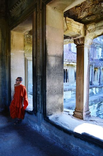 A monk inside the Angkor Wat temple complex Monk  Temple Angkor Wat Cambodia