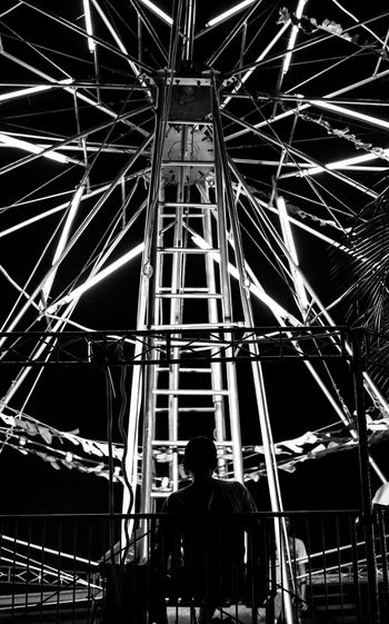 Wheel. Night Adults Only Illuminated People One Person One Man Only Adult Bnw Photography Bnw_shot Bnw_friday_challenge Street Bnw_society Bnw_life Bnwphotography Streetphotography Bnw_collection Portrait Bnw_friday_eyeemchallenge