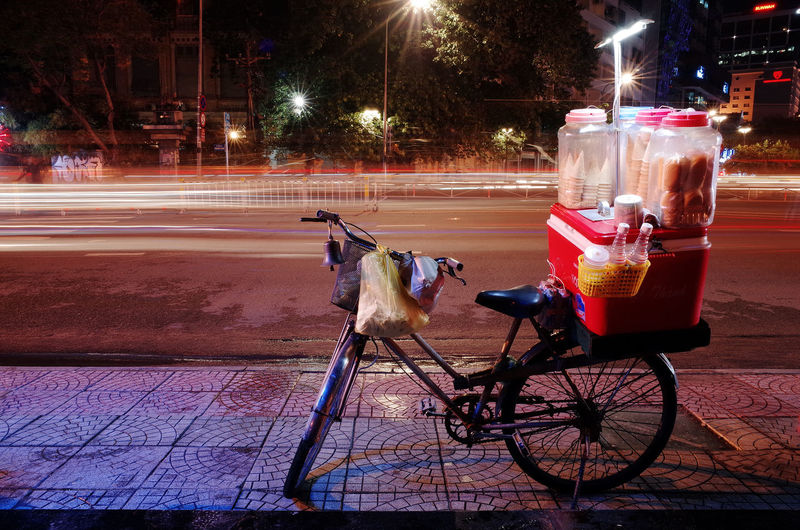 an ice-cream mobile vendor at Ho Chi Minh city Bicycle Cake Ho Chi Minh City Ice Cream Illuminated Light Long Exposure Mobile Vendo Night Night Life No People Outdoors Pavement Poor  Road Saigonlife Street Street Vendor Streetlife Travel Vietnam
