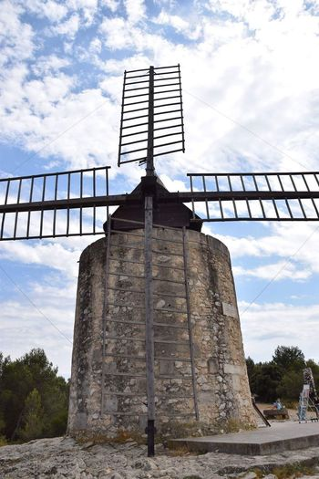 Cloud - Sky Low Angle View Sky Architecture Built Structure No People Day Outdoors Alternative Energy Tree Building Exterior Nature Windmill Fontvieille Mill Travel Wanderlust Travel Destinations EyeEm Best Shots EyeEm Nature Lover Travel Photography Eye4photography  Provence Windmill Traditional Windmill
