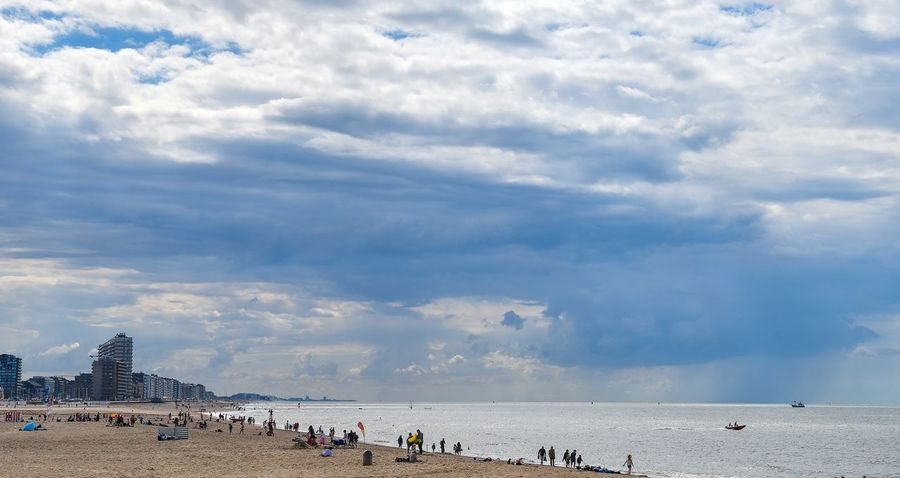 Cloud - Sky Large Group Of People Beach Sky Sea Water Sand Real People Vacations Day Tourism Nature Outdoors Leisure Activity Lifestyles Men Scenics Built Structure Architecture Horizon Over Water Ostend Oostende, Belgium Vlaanderen Sea And Sky Seascape