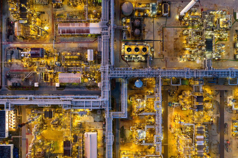 Aerial view of Oil refinery. Building Exterior Illuminated No People City Architecture Travel Aerial View Travel Destinations Yellow Connection Industry Technology Cityscape Built Structure Full Frame Outdoors Complexity Factory
