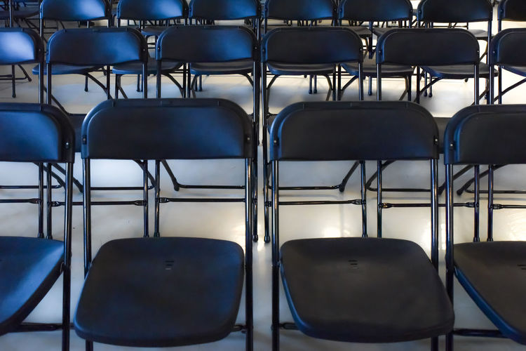Public Speaking Public Speaking Phobia Workshop Absence Arrangement Arts Culture And Entertainment Audience Blue Chair Concert Concert Seating Empty Full Frame Furniture In A Row Indoors  Lecture No People Order Rehearsal Repetition Seat Seats Seminar Side By Side