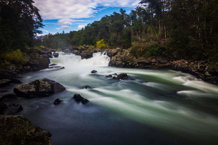 Trancura river... Aroundtheworld Beauty In Nature Blurred Motion Cloud - Sky Day Flowing Flowing Water Forest Long Exposure Motion Nature No People Outdoors Plant Power In Nature Rock Rock - Object Scenics - Nature Sky Solid Tourism Travel Destinations Tree Water Waterfall