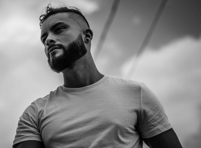 Black And White Portrait Queer Man EyeEm Selects Young Men One Person Casual Clothing Portrait Headshot Beard Young Adult Real People Front View Leisure Activity Men Looking Facial Hair Standing Handsome Lifestyles T-shirt Looking Away Day Human Face