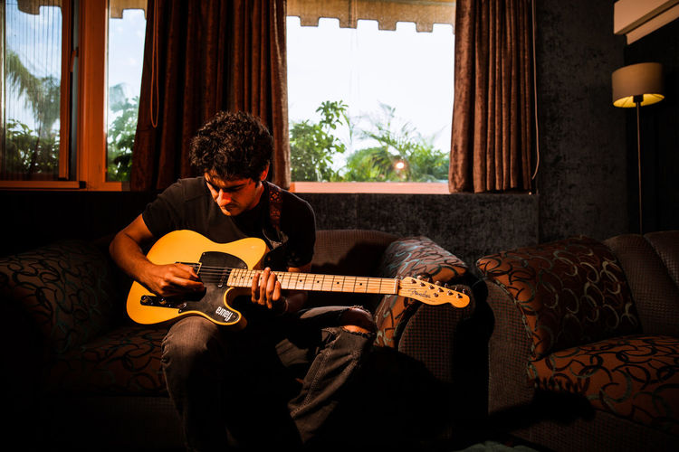A guitar player with his Fender stratocaster Fender Stratocaster Guitar Player That Boy Roby Band Indie Pop Artist Indie Scene In India Music Scene In Indi Musicians Ind Independent Music Scene Independent Music Indi