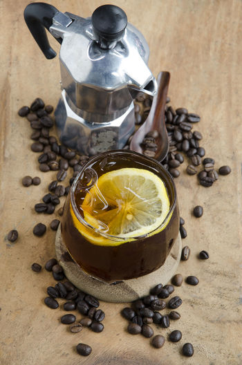 Coffee bean roasted and ice coffee. Close-up Coffee Bean Day Drink Food Food And Drink Freshness Healthy Eating High Angle View Ice Cream Indoors  Mokapot No People Preparation  Refreshment Roasted Coffee Bean Table