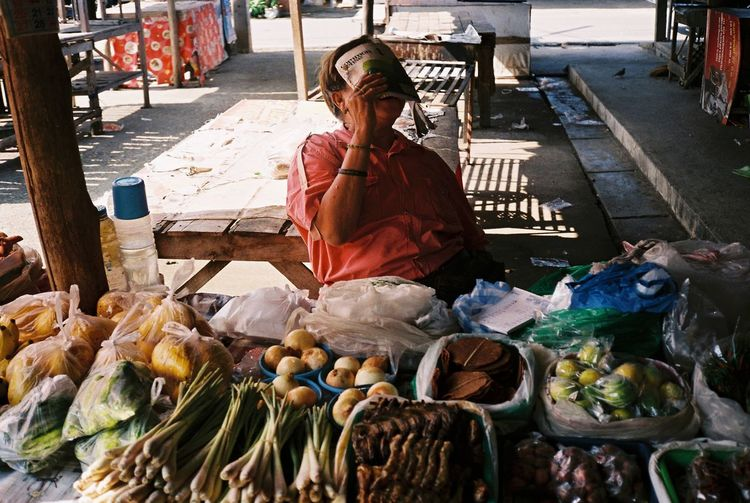 happy day life in her shop Buying Food Food And Drink Market Real People Retail  Vegetable Women