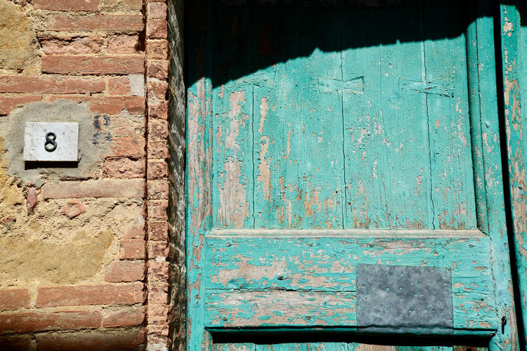 Old Architecture Entrance Built Structure Door Wall - Building Feature No People Weathered Building Exterior Day Wood - Material Wall Abandoned Brick Blue House Outdoors Damaged Textured  Close-up Deterioration Turquoise Colored