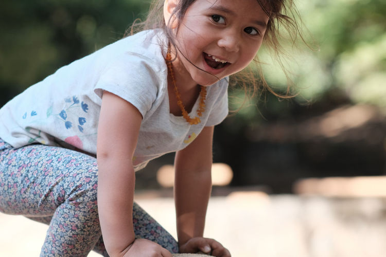 Close-Up Of Happy Girl Playing In Playground
