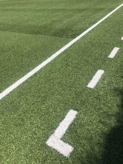 Shadow of woman on field