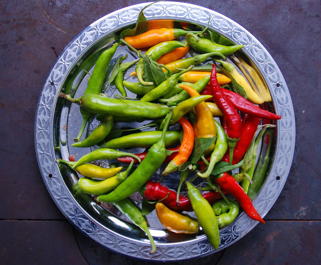 colorful chili peppers Chili Pepper Orange Red Hot Chili Peppers Chilli Close-up Colorful Day Food Food And Drink Freshness Green Chili Pepper Green Color Healthy Eating Indoors  Metal No People Paprika Platter Red Vegetable Vegetables Yellow