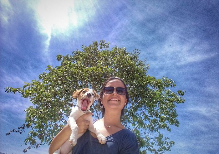 Two People Dog Portrait Puppyeyes Amor Tranquility Photography Day Grass Portrait Pets Nature Dog Vacations Sky Plant Tree Fragility Togetherness Sunglasses Outdoors Young Women Friendship Dogs Of EyeEm Animal Themes Freshness