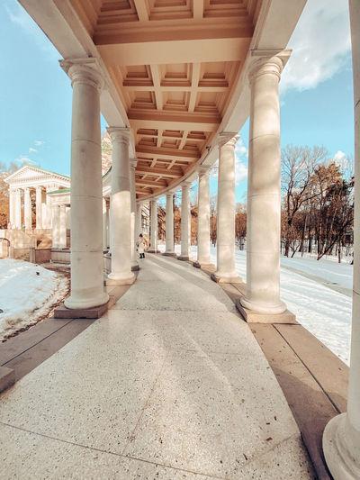 Corridor of historic building against sky