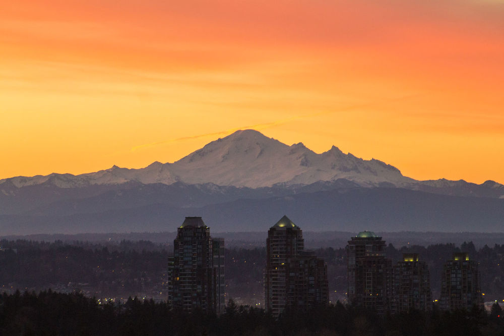 Mt. Baker in the Early Morning Architecture Beauty In Nature Building Exterior Built Structure Canada City Cityscape Clouds High Angle View Horizontal Landscape Mountain Mt. Baker No People Orange Color Outdoors Pink Scenics Silhouette Sky Skyscraper Snowcapped Sunrise Tranquil Scene Vancouver