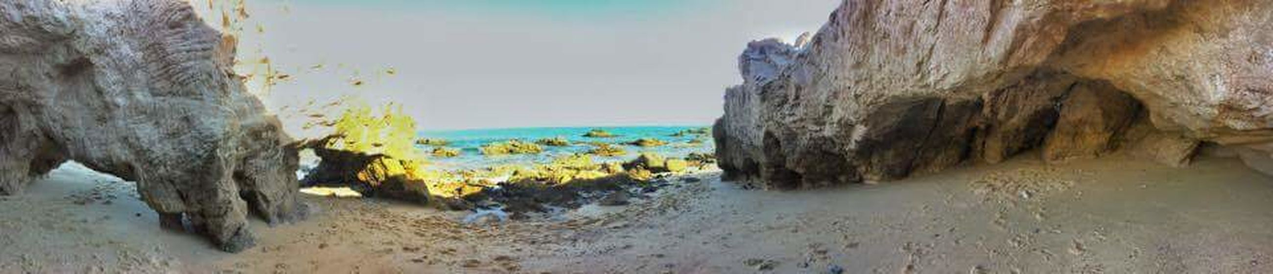 sea, nature, rock - object, water, beauty in nature, scenics, no people, beach, sky, day, outdoors, horizon over water