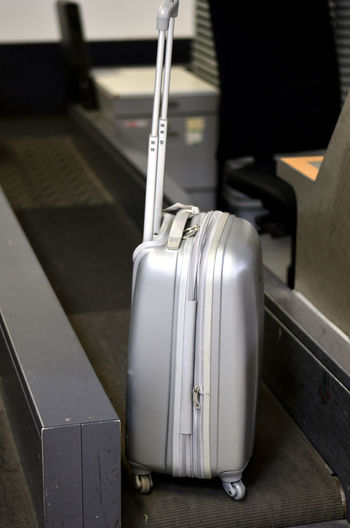 Close-up of suitcase at airport