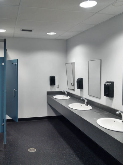 Simple but clean public washroom, row of sinks, mirrors and toilet stalls, grungy faded-color mobile shot Bathroom Bathroom Sink Washroom Toilet Public Public Restroom Restroom Sink Mirrors Row Simple Clean Indoors  Generic Grungy Indoors  Illuminated No People Mirror Lighting Equipment White Color Modern Domestic Room Privy Architecture Empty Recessed Light The Architect - 2019 EyeEm Awards
