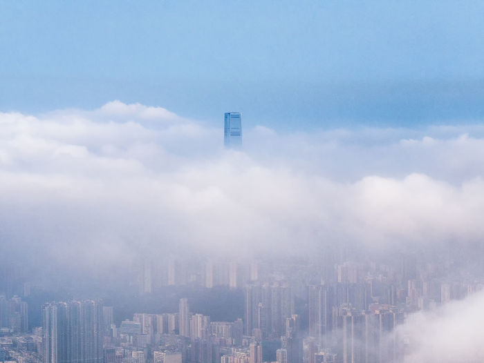 Cityscape amidst clouds