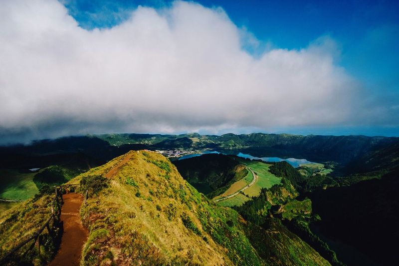 Sete Cidades in the Island São Miguel | Azores The colors are so amazing. It's like a painted picture. View Landscape_photography Landscape_Collection Hiking Landscape Wanderlust Nature Traveling Travel Destinations Travel Photography Sky Cloud - Sky Scenics - Nature Landscape Nature Environment Mountain Tranquility Beauty In Nature Tranquil Scene Plant No People Mountain Range Tree Outdoors Land Day Rural Scene Non-urban Scene Green Color
