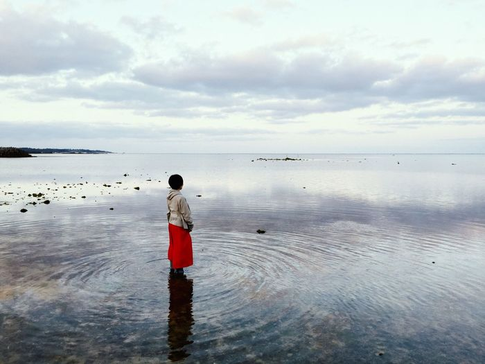 Side view of woman in calm sea