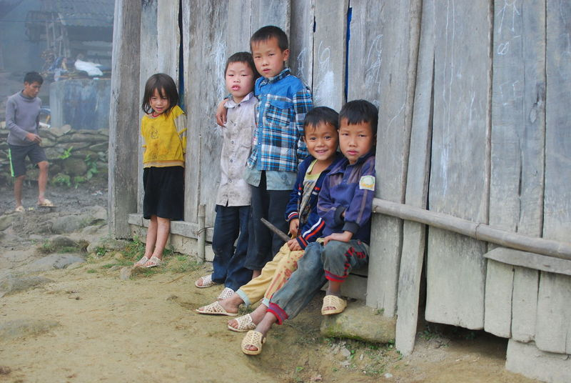 Sapa, Vietnam | 3 Bonding Boys Childhood Day Family Friends Front View Full Length Girls Group Hill Tribe Looking At Camera Person Sapa Sapa, Vietnam Shy Smile Togetherness Tribe
