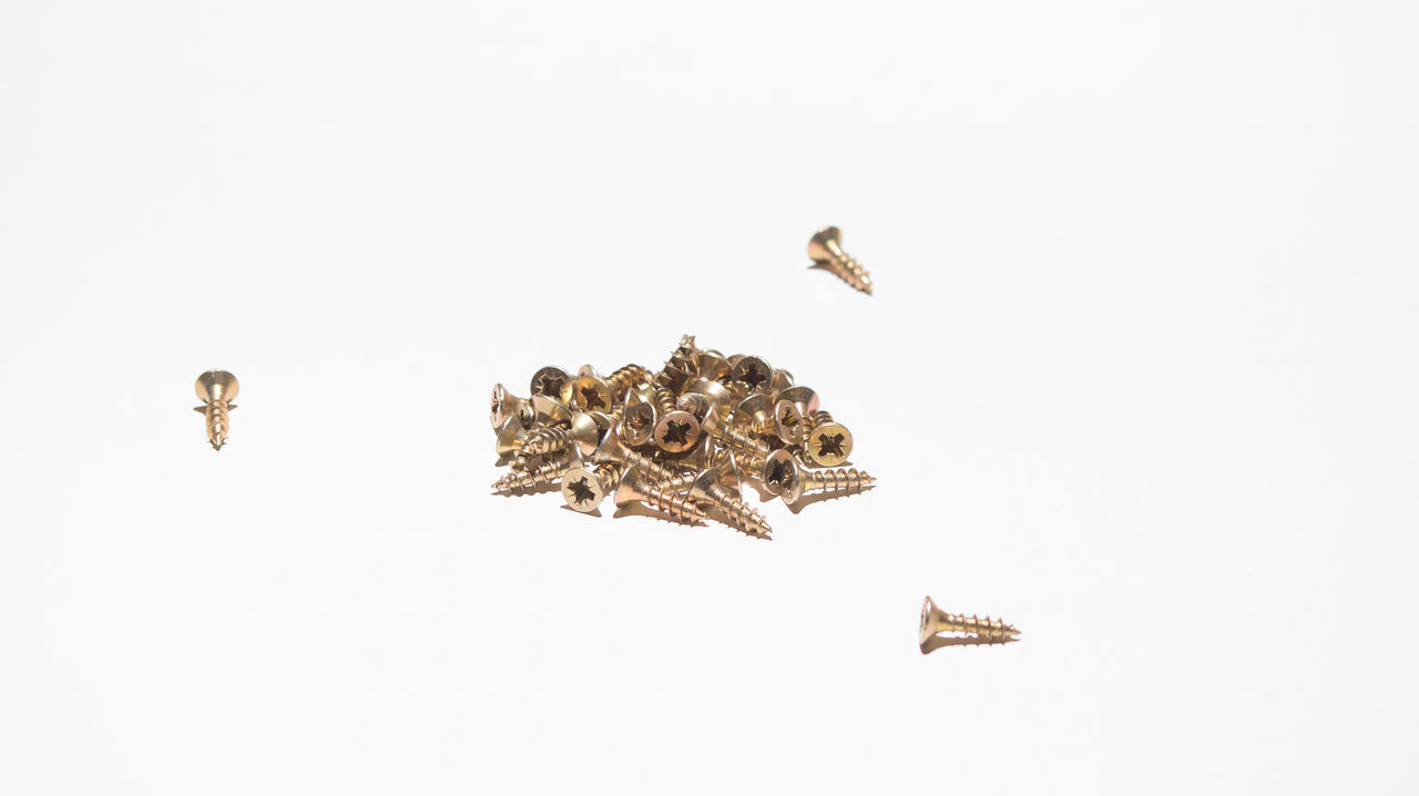 Bunch Of Screw Construction Golden Color In A Row Nail No People Peg Pieces Pile Pile Of Screw Screw Screw Art Screw It Screw Nail Screws Small Pieces Still Life Still Life Photograpy Studio Art Studio Shot White And Gold