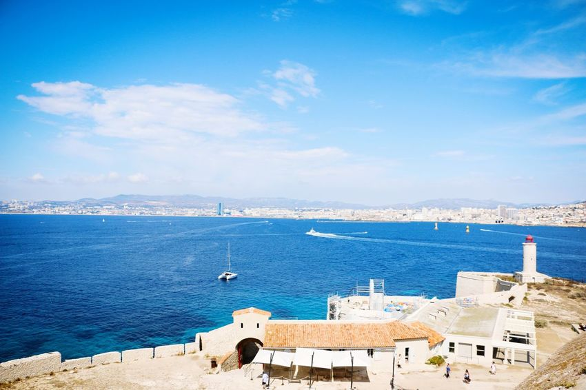 One of the most beautiful places I have ever seen Marseille Chateudif Island Sea Sea And Sky Sky Sunny Travel Destinations Seascape Blue Blue Sky Beautiful Nature Beautiful Places Beautiful Places Around The World No People Water Outdoors Travel Summer Summer Destination Travel Lover Amazing Sights