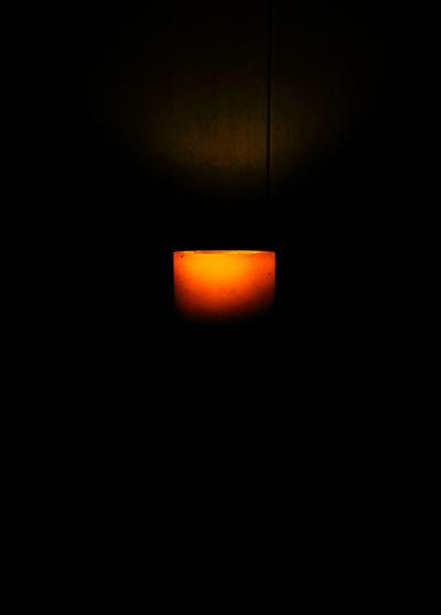 Illuminated lamp at sunset
