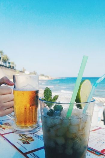 Drink Drinking Glass Drinking Straw Refreshment Cocktail Food And Drink Ice Cube Cold Drink Alcohol Beach Cold Temperature Summer Mojito No People Cola Sky Sea Day Water Tonic Water Summer Memories 🌄 Summer ☀ Mojito! 🍹 Beer Drinking Beer